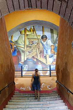 Mexico, Bajio, San Miguel de Allende, Bellas Artes Mural by Pedro Martinez dated 1940 with woman descending flight of stairs in foreground.