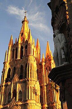 Mexico, Bajio, San Miguel de Allende, La Parroquia de San Miguel Arcangel neo-gothic exterior with statue of Ignacio Allende in foreground.