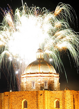 Mexico, Bajio, San Miguel de Allende, Independence Day fireworks over domed roof of the Church of San Francisco.