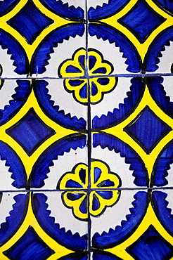 Mexico, Bajio, Queretaro, Blue white and yellow talavera tile detail.