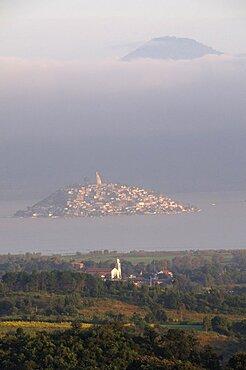 Mexico, Michoacan, Patzcuaro, Early morning misty view of Lago Patzcuaro with Isla Janitzio.
