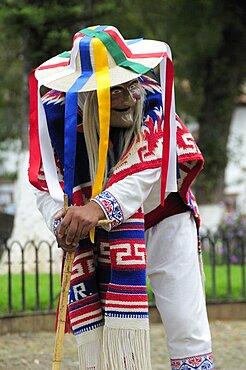 Mexico, Michoacan, Patzcuaro, Figure wearing mask and costume performing Danza de los Viejitos or Dance of the Little Old Men in Plaza Vasco de Quiroga.