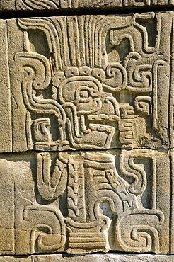 Mexico, Veracruz, Papantla, Relief carving of Mesoamerican god Quetzalcoatl the fethered serpent on wall of Juegos de Pelota Sur at El Tajin archaeological site.
