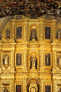 Mexico, Oaxaca, Church of Santo Domingo Interior and carved and gilded altarpiece with paintings and painted sculpted figures.