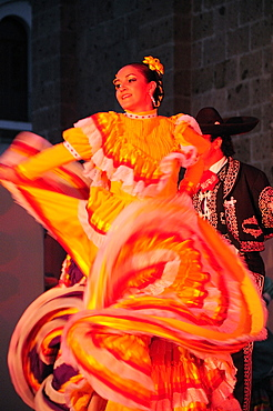 Mexico, Jalisco, Guadalajara, Plaza Tapatia Folk dancer from Jalisco State dancing at carnival.