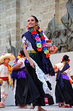Mexico, Jalisco, Guadalajara, Plaza Tapatia Woman folk dancer from Guerrero State performing in Carnival.