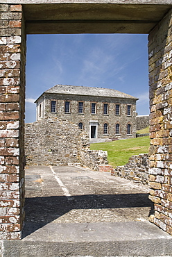 Ireland, County Cork , Kinsale, Charles Fort Museum building seen through the door way of a ruined building built in 1678.