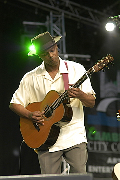 England, Cambridgeshire, Cambridge, Folk Festival Eric Bibb performing on stage with acoustic guitar.