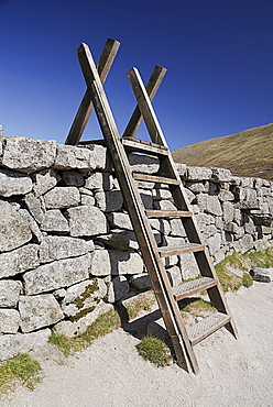 Ireland, County Down, Mourne Mountains, Typical stile over Mourne wall on Slieve Donard.
