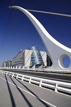 Ireland, County Dublin, Dublin City, Samuel Beckett bridge on the river Liffey with the Convention Centre.