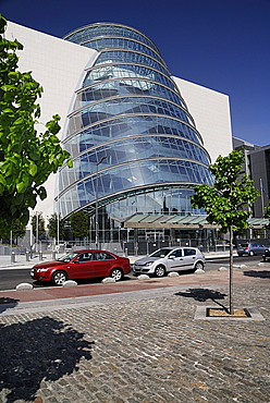 Ireland, County Dublin, Dublin City, Convention Centre building view of the facade with tree in foreground.
