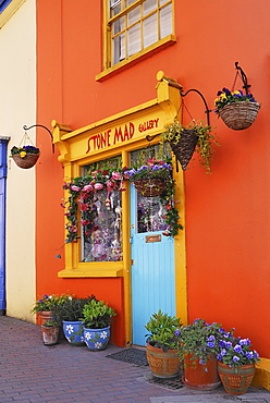 Ireland, County Cork, Kinsale, Colourful facade in market place with flower pots.