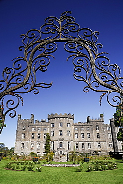 Ireland, County Sligo, Markree, Castle hotel castle and garden viewed through ornamental iron grille.