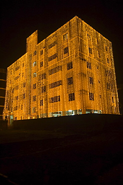 Bangladesh, Dhaka, Gulshan Apartment block at night lit up for a wedding with strings of fairy lights cascading over the side.