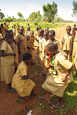 Burundi, Cibitoke Province, Buganda, Ruhagurika Primary School girls dancing during their playtime outside Catch-Up Class in Buganda Commune. Catch up classes were established by Concern Worldwide across a number of schools to provide a second chance for children who had dropped out.