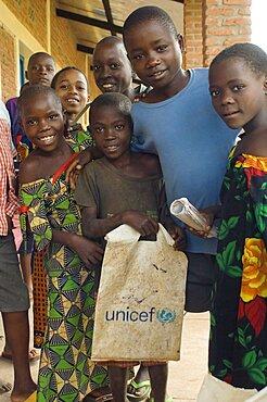 Burundi, Cibitoke Province, Buganda, School Children at a development project one holding a UNICEF carrier bag at Ruhembe Primary School.