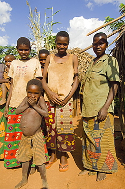 Burundi, Cibitoke Province, Kirundo, A family beside the road living in poverty child with obvious worms.