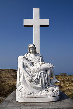 Ireland, County Cork, Sheeps Head Peninsula, Religious staue showing a Calvary scene.