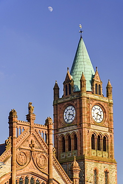Ireland, North, Derry, The Guildhall, The Clock Tower with moon in the sky above.