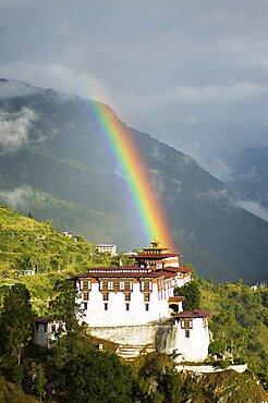 Bhutan, Lhuentse Dzong, Bhutan, Lhuentse Dzong with colourful rainbow overhead.