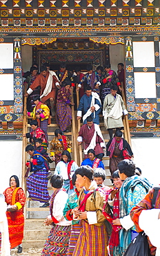 Bhutan, Gangtey Gompa, Tsecchu festival crowds descending temple steps dressed in their best clothes.