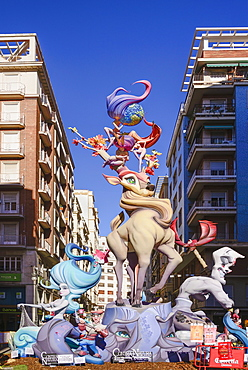Spain, Valencia Province, Valencia, Typical falla scene with Papier Mache figures in the street during Las Fallas festival.