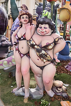 Spain, Valencia Province, Valencia, Two female Papier Mache figures in the street during Las Fallas festival.