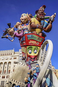 Spain, Valencia Province, Valencia, Las Fallas scene with Papier Mache figures on a Bus Turistic in Plaza Ayuntamiento during Las Fallas festival.