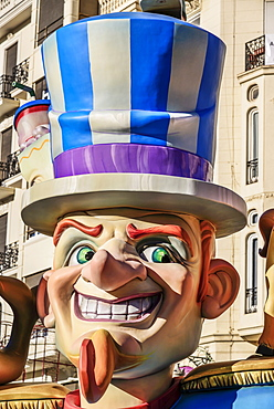 Spain, Valencia Province, Valencia, Papier Mache figure in the street during Las Fallas festival.