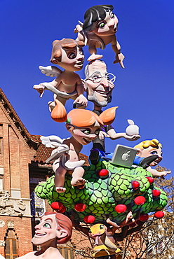 Spain, Valencia Province, Valencia, Papier Mache figures in the street during Las Fallas festival.
