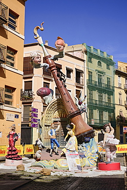 Spain, Valencia Province, Valencia, Falla scene with Papier Mache figures in the streets of the Carmen district during Las Fallas festival.