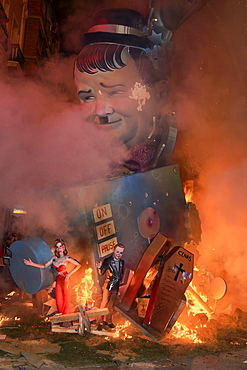 Spain, Valencia Province, Valencia, La Crema, The Burning of the Papier Mache figures in the street during Las Fallas festival on March 19th, Oliver Hardy going up in flames.