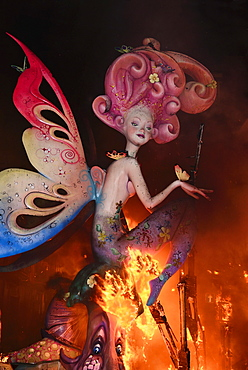 Spain, Valencia Province, Valencia, La Crema, The Burning of the Papier Mache figures in the street during Las Fallas festival on March 19th, fairy figure going up in flames.
