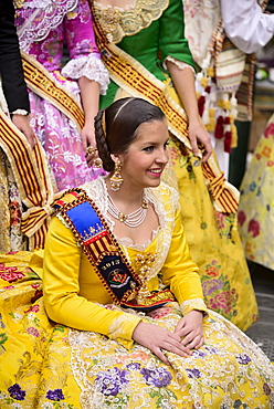 Spain, Valencia Province, Valencia, Reina Fallera in traditional Valencian costume taking a break during Las Fallas festival.