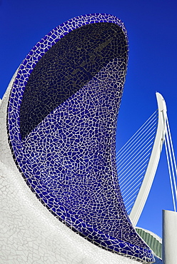 Spain, Valencia Province, Valencia, Spain, Valencia Province, Valencia, La Ciudad de las Artes y las Ciencias, City of Arts and Sciences, An arch of the Umbracle sculpture garden with El Pont de l'Assut de l'Or bridge in the background.