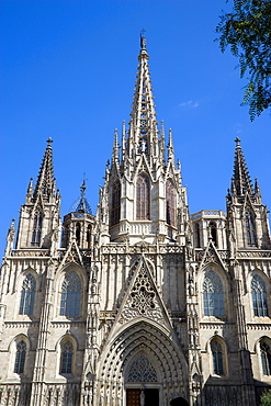 Spain, Catalonia, Barcelona, The spire and main facade of the Cathedral in the Old Town district., 1,