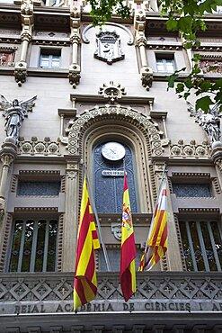 Spain, Catalonia, Barcelona, The theatre Reial Academia de Ciencies i Arts with the city's first official public clock on La Rambla.