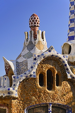 Spain, Catalunya, Barcelona, Parc Guell by Antoni Gaudi, roof detail of the Administration Lodge at the park's entrance.