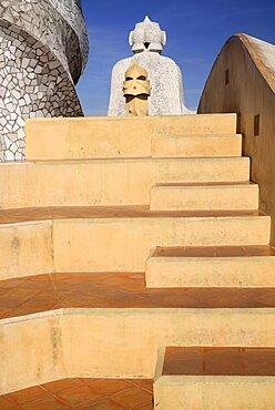 Spain, Catalunya, Barcelona, Antoni Gaudi's La Pedrera building, a section of chimney pots on the roof terrace.