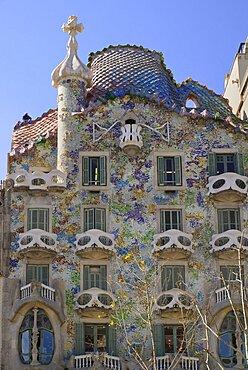 Spain, Catalunya, Barcelona, Casa Batllo by Antoni Gaudi, a section of the exterior facade.