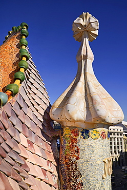 Spain, Catalunya, Barcelona, Antoni Gaudi's Casa Batllo building, dragon's back feature on the roof terrace with the four armed cross also inclluded.