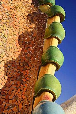 Spain, Catalunya, Barcelona, Antoni Gaudi's Casa Batllo building, detail of dragon's back feature on the roof terrace.