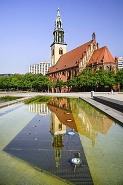Germany, Berlin, Marienkirche, St Marys Church dating from the 13th Century, reflected in fountain pool.