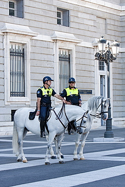 Spain, Madrid, Mounted policemen outside the Palacio Real.