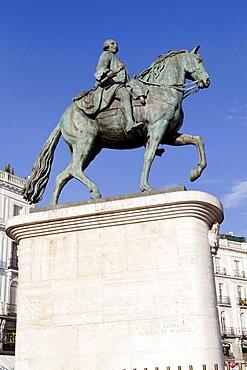 Spain, Madrid, Statue of King Carlos III on Puerta del Sol.