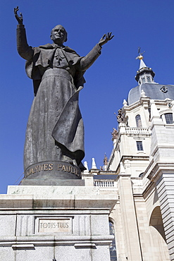 Spain, Madrid, Cathedral de la Almudena with statue of Pope John Paul II in the courtyard.