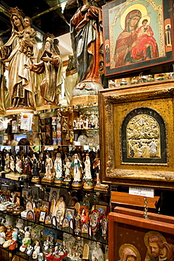 Spain, Madrid, Interior of shop selling religious statues and paraphenalia.