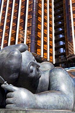 Spain, Madrid, Fernando Botero's statue of a fat lady lying down at Plaza de Colon.