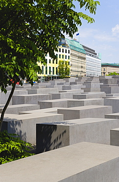Germany, Berlin, Mitte, Holocaust Memorial designed by US architect Peter Eisenmann with a field of grey slabs symbolizing the millions of Jews killed by the Nazis.
