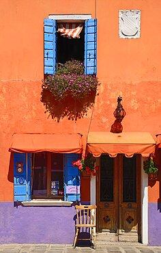 Italy, Veneto, Burano Island, Colourful row of house facades.